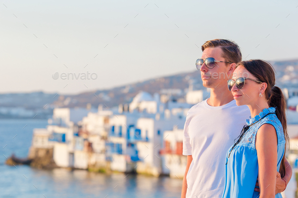 Family in Europe. Happy couple in Little Venice background on Mykonos Island, in Greece - Stock Photo - Images