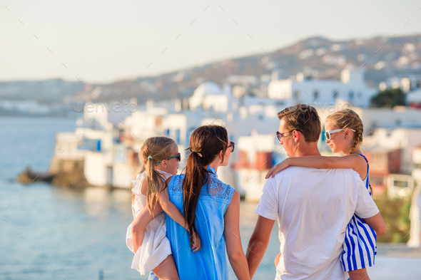Family vacation in Europe. Parents and kids on Little Venice background on Mykonos Island, in Greece - Stock Photo - Images