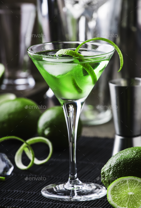 Green alcoholic cocktail martini glass with dry gin - Stock Photo - Images