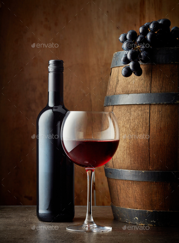glass and bottle of red wine - Stock Photo - Images