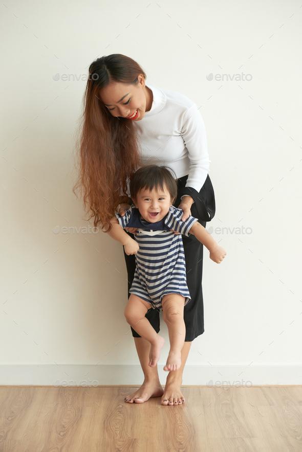 Enjoying time with baby boy - Stock Photo - Images