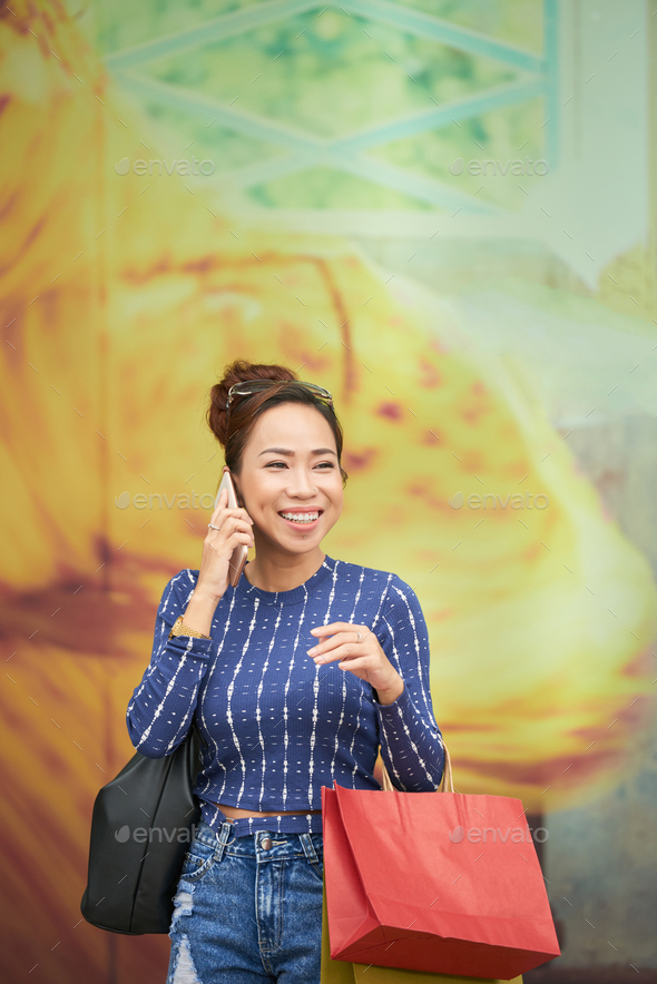 Woman talking on the phone - Stock Photo - Images