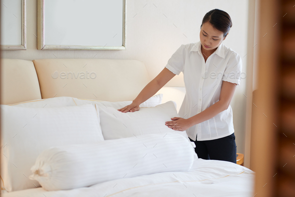 Arranging bed - Stock Photo - Images