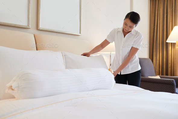 Making bed - Stock Photo - Images