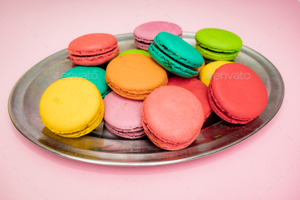 A lot of french colorful macarons on a pink background - Stock Photo - Images