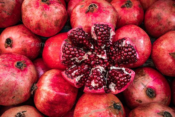 Red pomegranate fruit at street market. Group of pomegranates - Stock Photo - Images