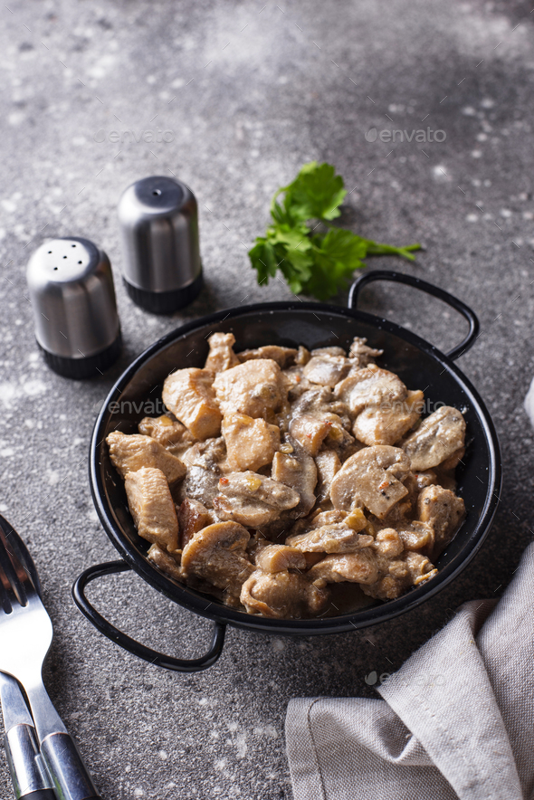Stewed chicken fillet with mushrooms - Stock Photo - Images