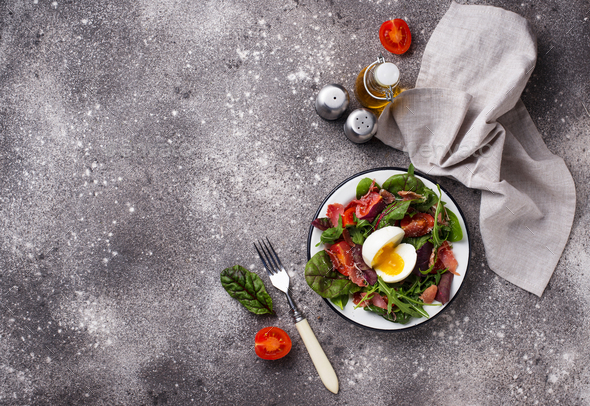 Healthy salad with prosciutto, tomato and egg - Stock Photo - Images