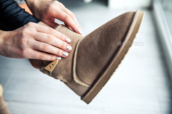 The girl with a nice manicure gray dress boots. Shoes, fashion, style, modern - Stock Photo - Images
