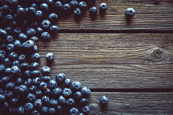 Blueberry on Wooden Background. Fruits, food, organic - Stock Photo - Images