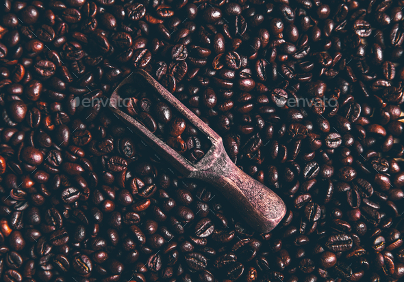 Coffee beans and an old wooden scoop - Stock Photo - Images
