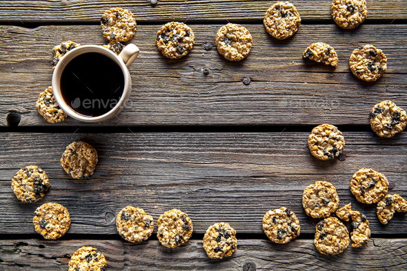 cookies with chocolate and coffee on a wooden background. drink, sweets, breakfast - Stock Photo - Images