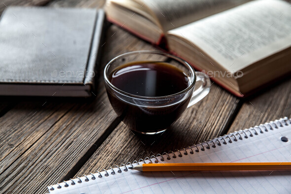 books and a cup of coffee on a wooden background - Stock Photo - Images