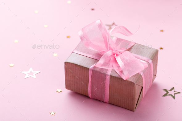 Gift box with pink ribbon - Stock Photo - Images