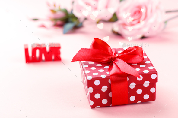 Retro style red polka dots gift box - Stock Photo - Images