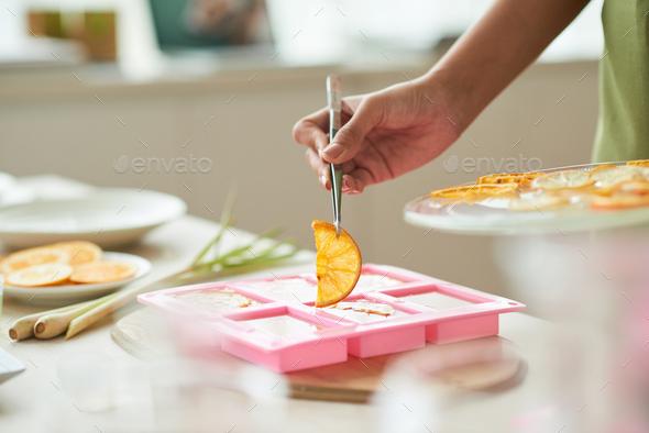 Adding orange for decoration - Stock Photo - Images
