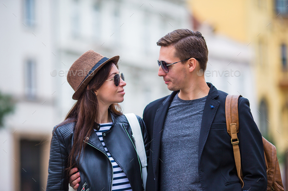 Happy couple walking in Europe. Smiling lovers enjoying cityscape with famous landmarks - Stock Photo - Images