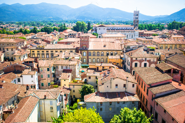 Beautiful view of ancient building with red roofs in Lucca, Italy - Stock Photo - Images