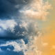 Dramatic Blue Thunderclouds, Stunning Yellow-Golden Fluffy Clouds Illuminated by Rays of Sun - PhotoDune Item for Sale