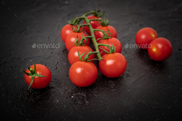 Fresh cherry tomatoes on a black background - Stock Photo - Images