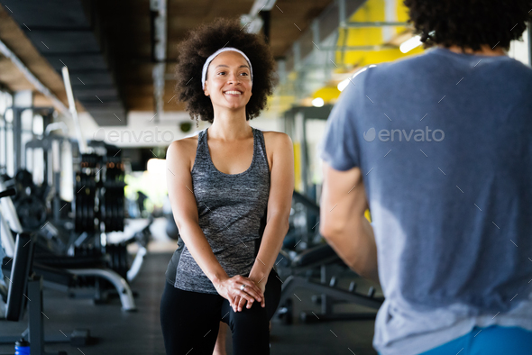 Picture of cheerful fit fitness team in gym - Stock Photo - Images