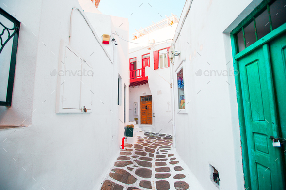 The narrow streets of greek island with white balconies, stairs and colorful doors. Beautiful - Stock Photo - Images