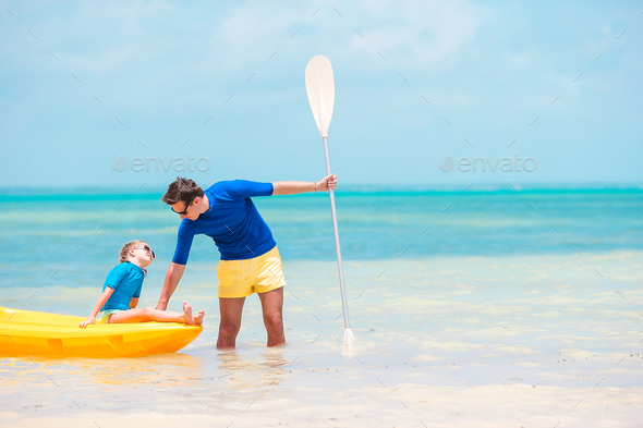 Young father and little kid kayaking at the sea - Stock Photo - Images