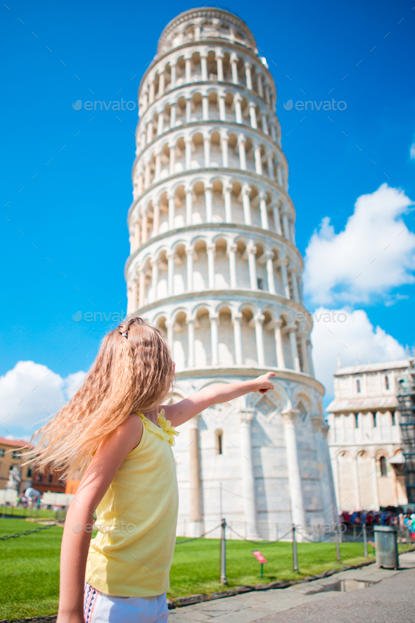 Little girl on italian vacation near the famous Leaning Tower of Pisa - Stock Photo - Images