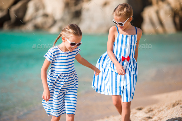 Adorable little girls during summer vacation. Kids enjoy their travel in Greece - Stock Photo - Images