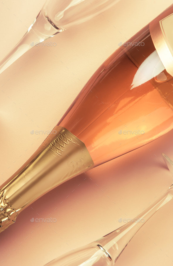 Bottle with pink sparkling wine or rose champagne - Stock Photo - Images