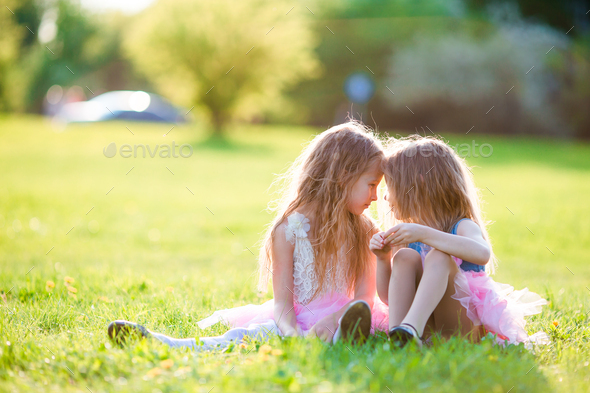 Adorable little girls on spring day outdoors - Stock Photo - Images
