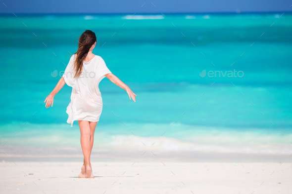 Young beautiful girl on tropical beach at caribbean vacation - Stock Photo - Images