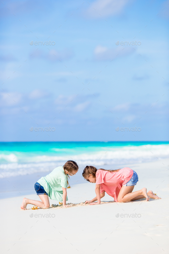 Adorable little girls during summer tropical vacation - Stock Photo - Images