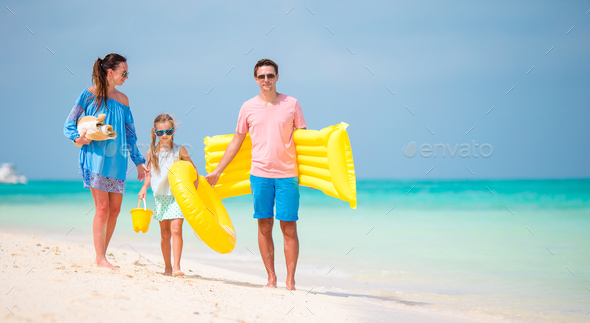 Young family enjoy beach vacation - Stock Photo - Images