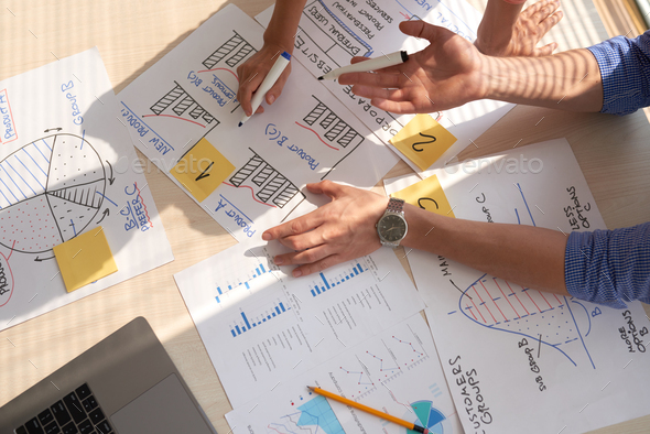 Discussing business graphs - Stock Photo - Images
