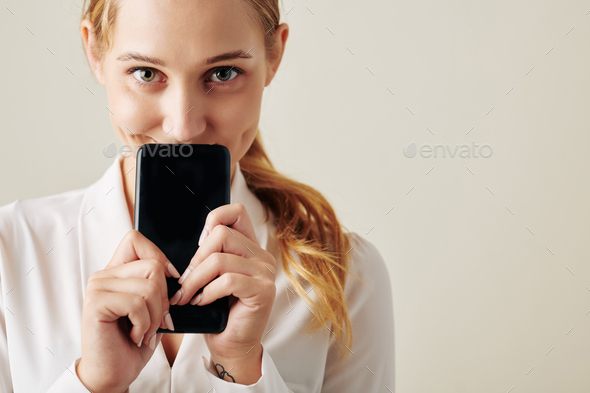 Excited woman with smartphone - Stock Photo - Images