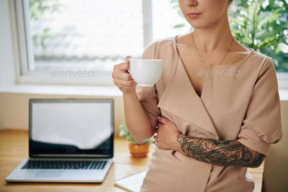 Woman drinking cup of tea - Stock Photo - Images