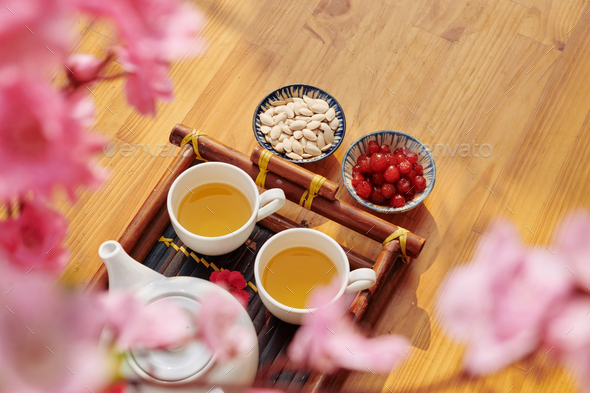 Tea with seeds and berries - Stock Photo - Images