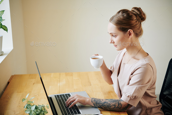 Woman reading news online - Stock Photo - Images