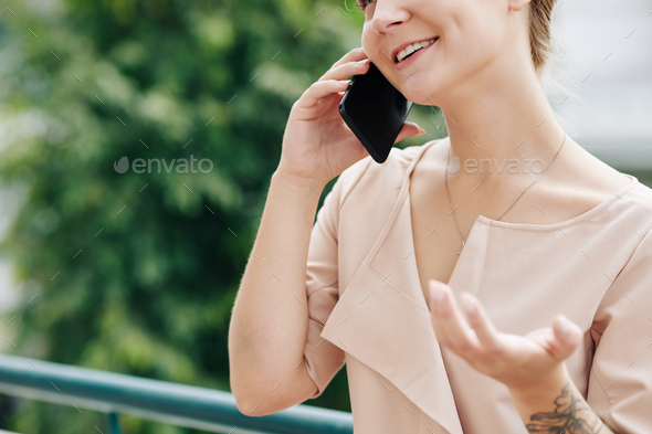 Young woman calling on phone - Stock Photo - Images