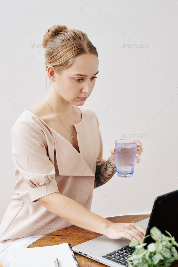 Young woman checking e-mails - Stock Photo - Images