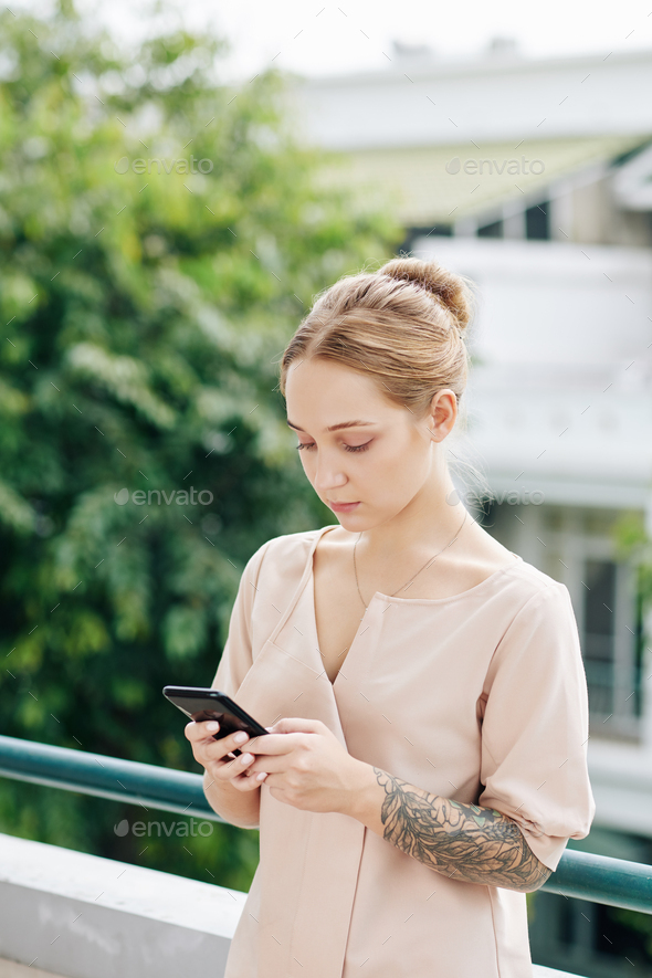 Charming woman using mobile application - Stock Photo - Images