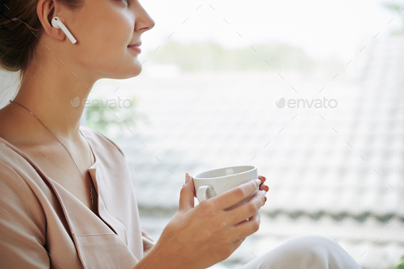 Woman listening to music - Stock Photo - Images