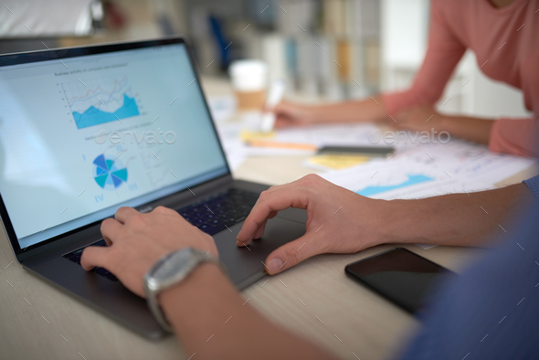 Working with financial chart - Stock Photo - Images