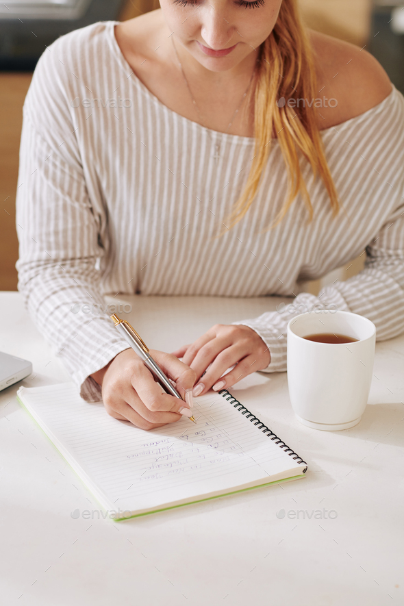 Young woman writing affirmations - Stock Photo - Images