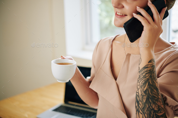 Positive woman talking on phone - Stock Photo - Images