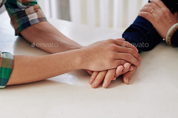Son reassuring mother - Stock Photo - Images