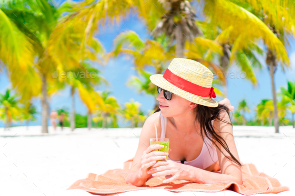 Young beautiful woman relax with cocktail on white tropical beach - Stock Photo - Images