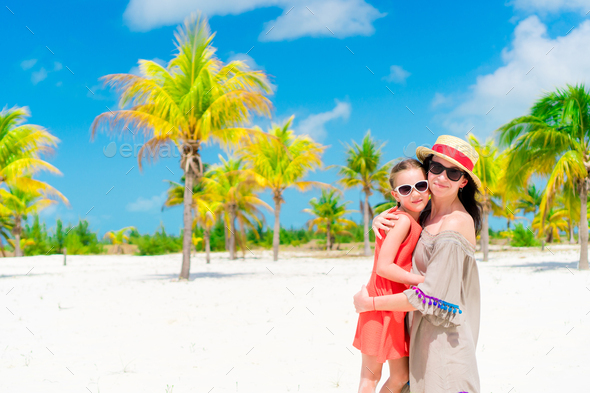 Little adorable girl and young mother at tropical beach - Stock Photo - Images
