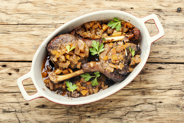Roasted duck leg with apple sauce - Stock Photo - Images